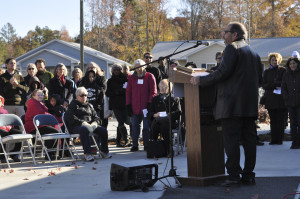 Mark speaks at the dedication of the Rogers Road Community Center.